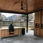 large green egg grill table on patio